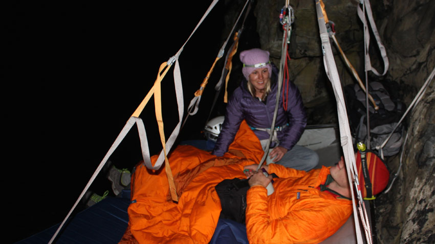 Campers on a cliff-face at night