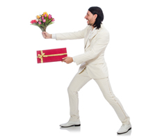 man giving fowers and gift