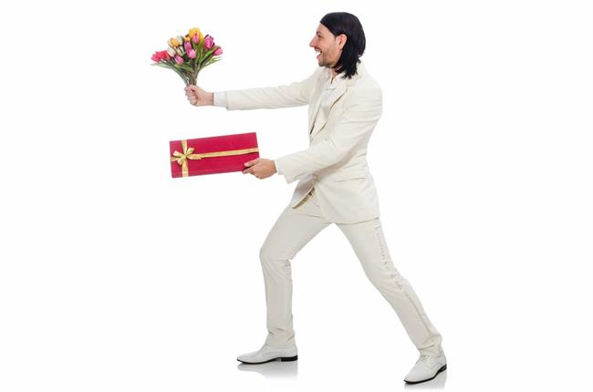 man giving flowers and gift