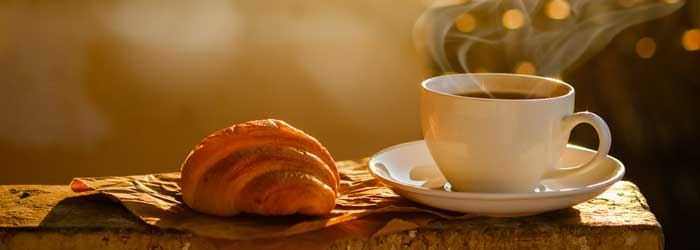 Croissant and coffee (Shutterstock, mirtmirt)
