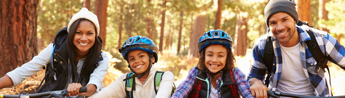 Family-cycling-in-forest (Shutterstock, Monkey Business Images)