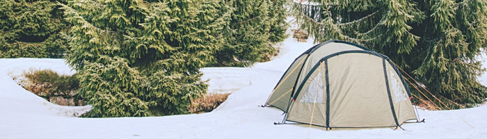 green-tent-in-the-snow (shutterstock, rdonar)