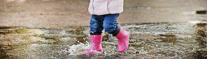 toddler walking in puddle (shutterstock, JetKat)